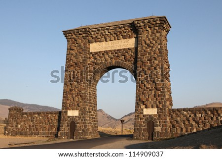 The Roosevelt Arch at the North entrance to Yellowstone National Park. - stock photo