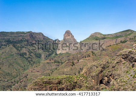The Roque de Agando, a huge volcanic plug 1250m high, and the Barranco de Benchijiguaon on La Gomera, Canary Islands. The Roque Agando is one of a group of volcanic plugs near the Garajonay Park  - stock photo
