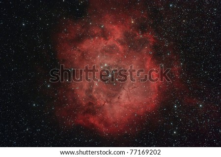 The Rosette Nebula (also known as Caldwell 49) is a large, circular H II region located near one end of a giant molecular cloud in the Monoceros region of the Milky Way - stock photo