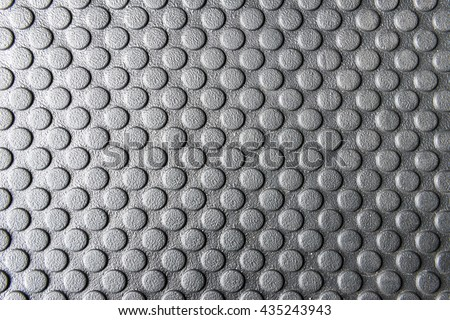 The round pattern texture on the rubber mats for the anti-slip purpose in the black and white scene. - stock photo