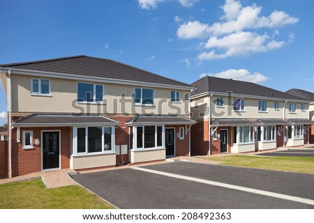 The row of detached houses - stock photo