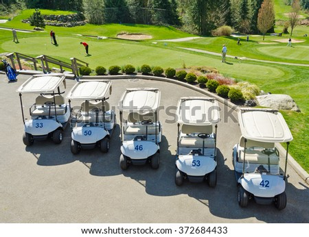 The row of the golf carts at the golf course. - stock photo