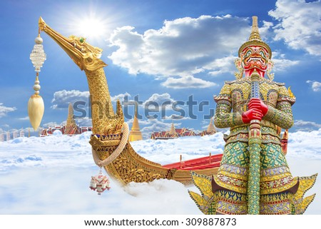 The Royal Barge Suphannahong with Giant guardian wat phra kaew grand palace  flying on paradise the clouds bangkok, thailand travel thailand travel concept