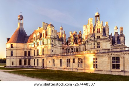 The royal Chateau de Chambord at sunset, France. This castle is located in the Loire Valley, was built in the 16th century and is one of the most recognizable chateaux in the world. - stock photo