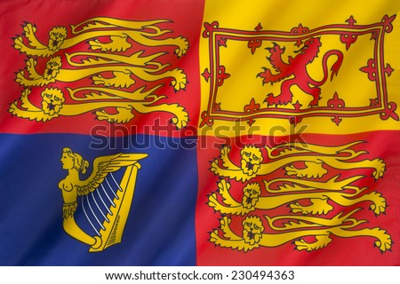 The Royal Standard of the United Kingdom is the flag used by Queen Elizabeth II in her capacity as Sovereign of the United Kingdom and its overseas territories.  - stock photo