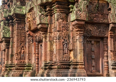 The ruins carving of Banteay Srei temple in Siem Reap, Cambodia. Banteay Srei or Banteay Srey is a 10th century Cambodian temple dedicated to the Hindu god Shiva. - stock photo