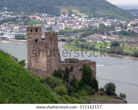 The ruins of a medieval fortress in the background of the merger of the Rhine and the Main River, Germany - stock photo