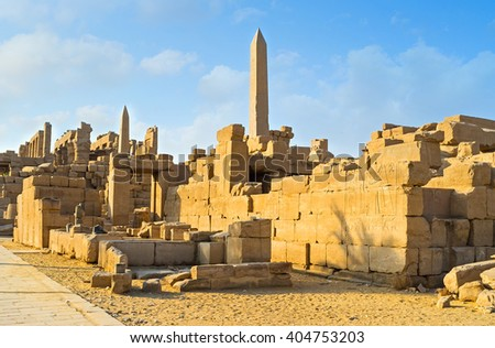 The ruins of Karnak Temple Complex with the rising granite obelisks on the background, Luxor, Egypt. - stock photo