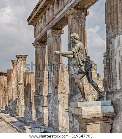 The ruins of Pompeii, destroyed by the eruption of Mount Vesuvius. Statue Apallon. Italy. - stock photo