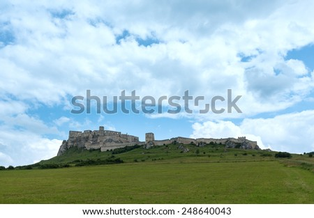 The ruins of Spis Castle or Spissky hrad in eastern Slovakia. Summer view. Built in the 12th century. - stock photo