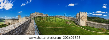 The ruins of Spis Castle (Slovak: Spissky hrad, Hungarian: Szepesi var; German: Zipser Burg) in eastern Slovakia form one of the largest castle sites in Central Europe. - stock photo