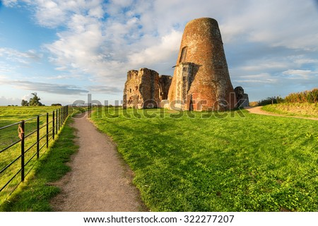 The ruins of St Benet's Abbey and it's adjoining windmill on the Norfolk Broads. - stock photo