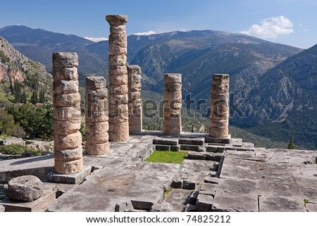 The ruins of Temple of Apollo in the archaeological site of Delphi in Greece; Delphi was believed to be the centre of the earth - stock photo
