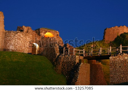 The ruins of the castle at Urquhart at night near Inverness on the banks of Loch Ness in Scotland - stock photo