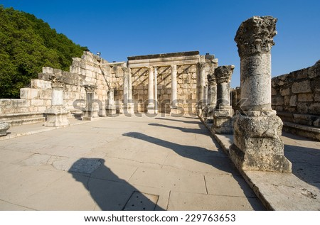 The ruins of the synagogue in the small town Capernaum on the coast of the lake of Galilee.  According to the bible this is the place where Jesus taught - stock photo