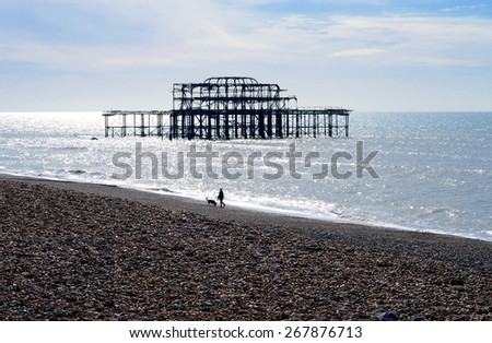 The ruins of the West Pier in the light of the rising sun. It is situated in Brighton, England and is one of the icons of the city.  - stock photo