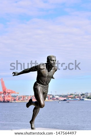 The runner statue in Stanley Park BC - stock photo