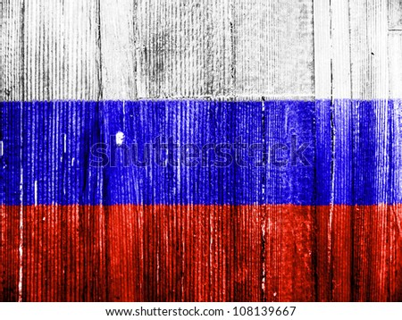 The Russian flag painted on wooden pad - stock photo