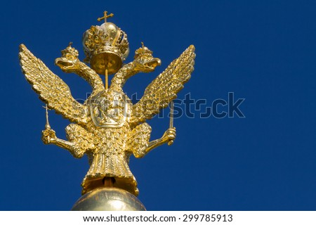 The russian national symbol, a double headed eagle, in gold in Peterhof, St. Petersburg, Russia - stock photo