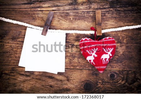 The rustic wooden background with hearts and notes. - stock photo