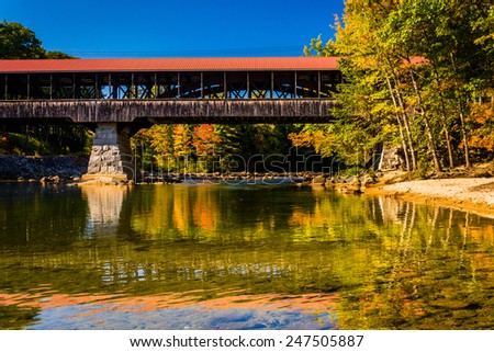 The Saco River Covered Bridge in Conway, New Hampshire. - stock photo