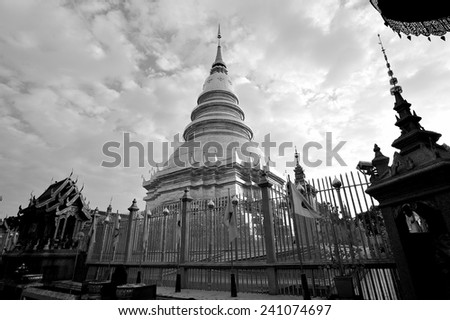 the sacred pagoda of Wat Phra That Hariphunchai, Lamphun, Thailand in black and white - stock photo