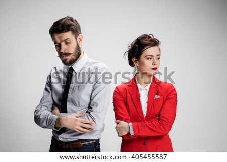 The sad business man and woman conflicting on a gray background - stock photo