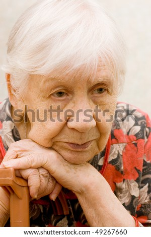 The sad old woman in a room - stock photo