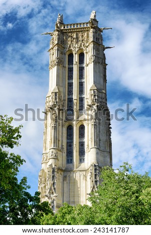 The Saint-Jacques Tower in the Gothic style with a belfry in Paris, France. Paris is one of the most popular tourist destinations in Europe. - stock photo