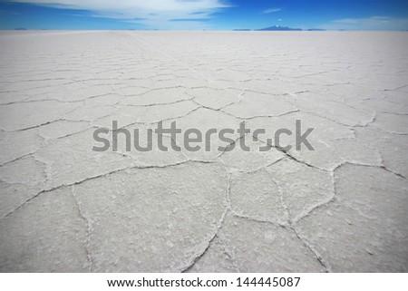 The salt crystals at Salt Lake of Uyuni in Bolivia  - stock photo