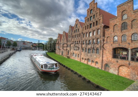 The Salzspeicher (salt storehouses) of Lubeck, Germany, are historic brick buildings on the Upper Trave River next to the Holstentor (the western city gate), built in the 16th-18th Century - stock photo