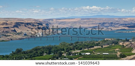 The Sam Hill Memorial Bridge across the Columbia River gorge connecting Washington on the right to Oregon on the left. - stock photo