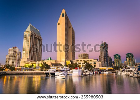 The San Diego skyline at twilight, seen from Embarcadero Marina Park North, in San Diego, California. - stock photo