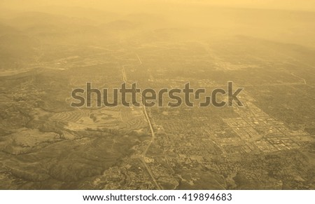 The San Fernando Valley aka The Valley in the Los Angeles metropolitan area of southern California defined by the mountains of the Transverse Ranges circling it - vintage sepia look - stock photo