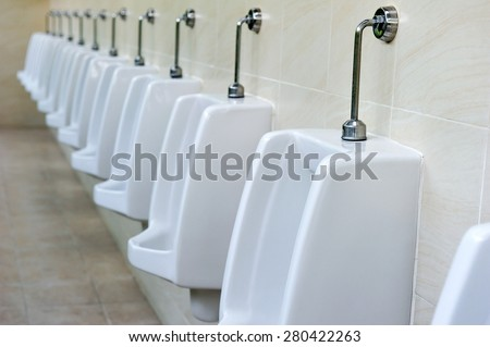 The sanitary ware for men in toilet. - stock photo