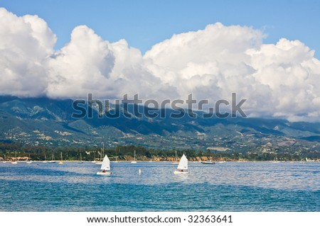 The Santa Barbara coastline with foreground sailboats. - stock photo