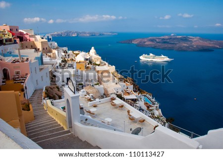 The Santorini island. Morning view of the harbor, the volcano and township - stock photo