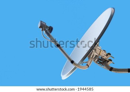 The satellite television aerial on a blue background - stock photo