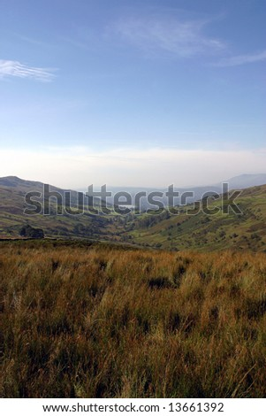 The scenery over the fells and Coniston Water in the Lake District, Cumbria (England) - stock photo