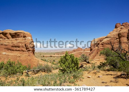 The scenic byway (U-128) along the Colorado River in Utah. This is the road to Moab near Arches National Park. - stock photo