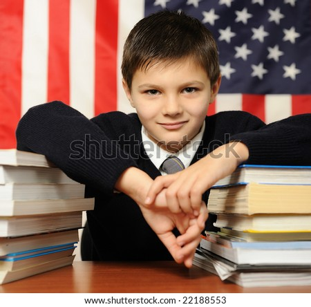 The schoolboy against the American flag - stock photo