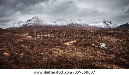 The Scottish Highlands. Snowy mountains of Glamaig on a cloudy spring day - Isle of Skye, Scotland, UK - stock photo