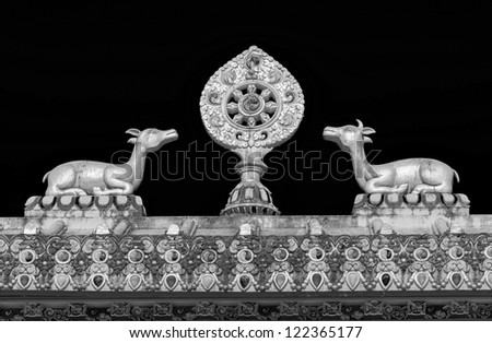 The sculpture of the wheel of Dharma and two deer on the roof of the gate of the monastery Tengboche - Nepal, Himalayas - stock photo