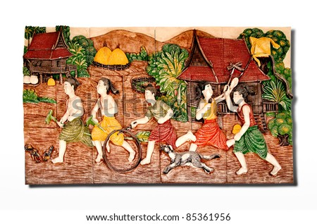 The Sculpture thai children of native thai style. This is traditional and generic style in Thailand. No any trademark or restrict matter in this photo. - stock photo