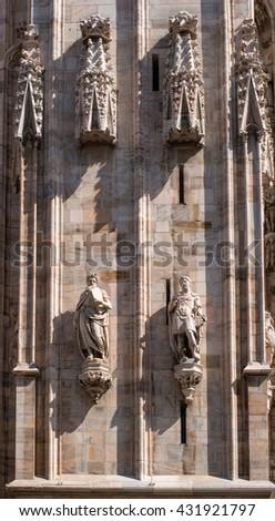 The sculptures on the facade of the Duomo. Milan, Italy.2 - stock photo