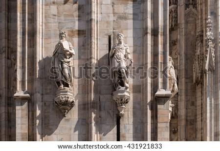 The sculptures on the facade of the Duomo. Milan, Italy. 1 - stock photo
