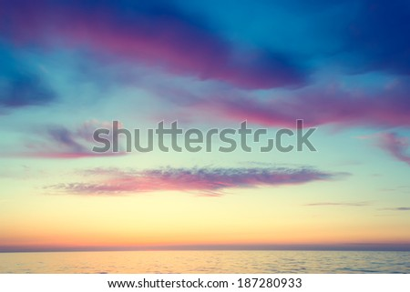 The sea at sunset.Colorful sky full of emotion - stock photo