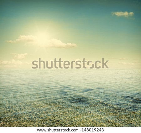 The sea is calm and the sun - stock photo