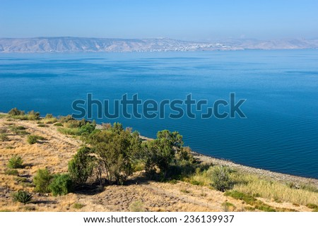 The sea of Galilee in Israel as seen from the east coast, the city on the other side is Tiberias - stock photo