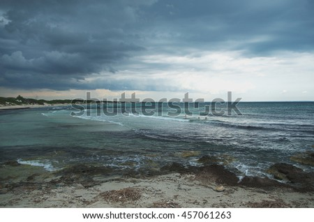 The sea, the beach against a dramatic sky. Abtract concept: dramatic scene, gloomy atmosphere - stock photo